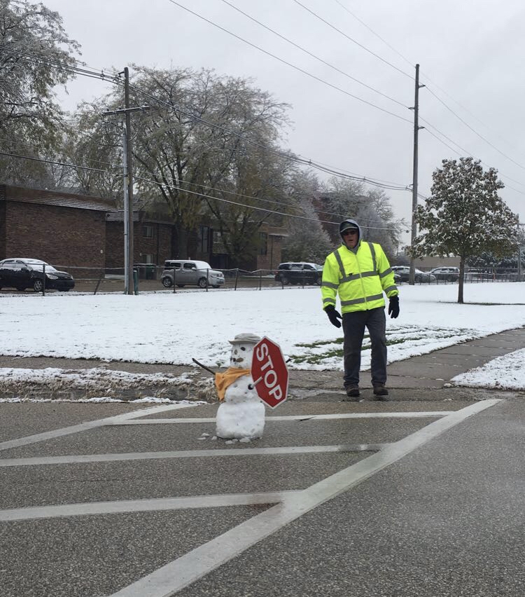 Crossing guard and snowman at Gale Elementary
