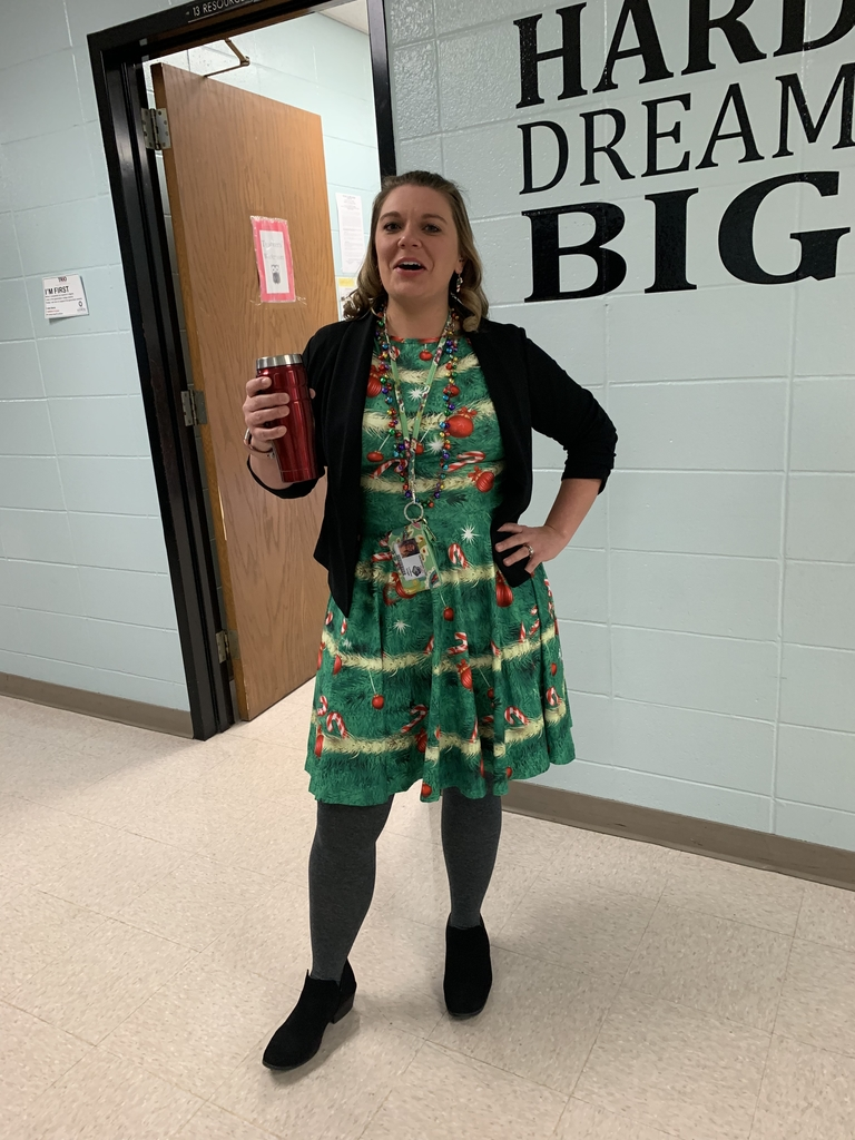 "Mrs. Knight and her ""ugly Christmas sweater"" apparel"