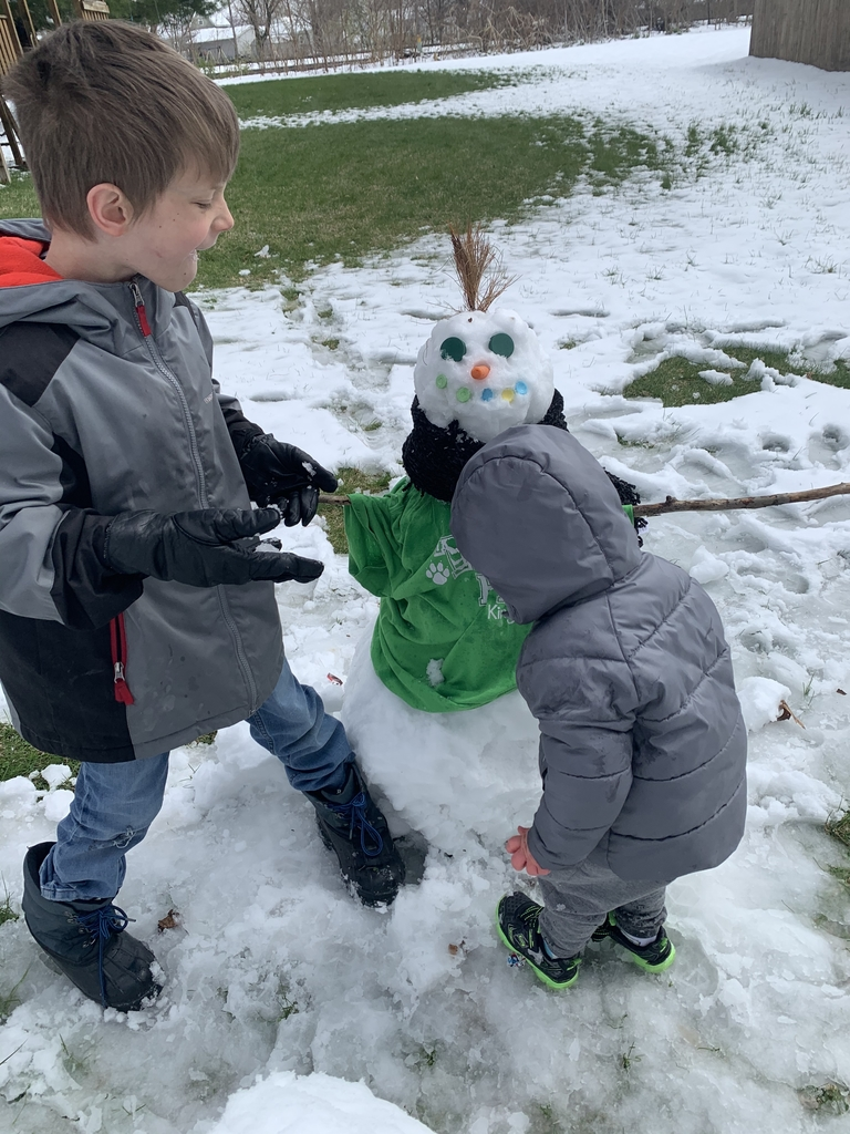 Asher and Ben check out the snow boy.